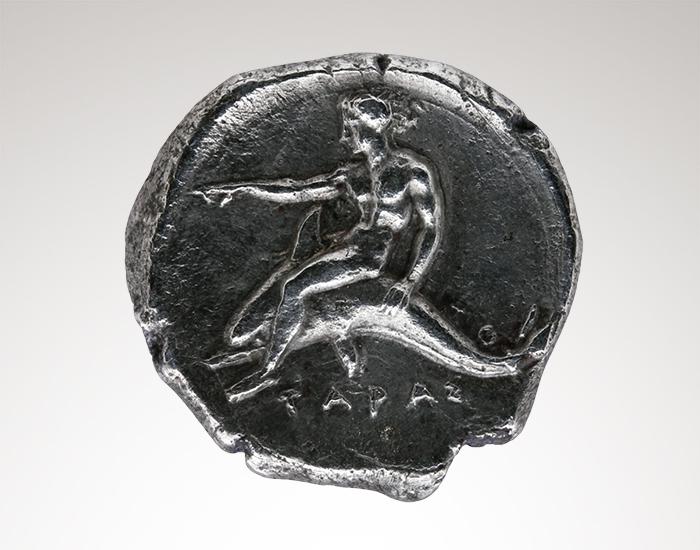Münze mit Delfinreiter